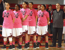 "<div class=""source"">Stephen Lega</div><div class=""image-desc"">The Marion County Lady Knights and Coach Trent Milby stand at attention during the national anthem before the state championship game Saturday night.</div><div class=""buy-pic""><a href=""/photo_select/26255"">Buy this photo</a></div>"