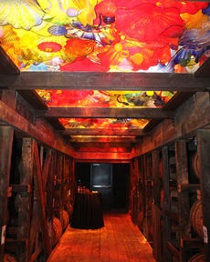"""<div class=""""source"""">Photo by Nick Schrager</div><div class=""""image-desc"""">A glass art installation by world-renowned artist Dale Chihuly was unveiled today, March 26, in one of Maker's Mark Distillery's rack houses.</div><div class=""""buy-pic""""><a href=""""/photo_select/33398"""">Buy this photo</a></div>"""