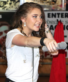 """<div class=""""source"""">Emily LaForme</div><div class=""""image-desc"""">Marion County's own Layla Spring, a contestant on """"American Idol,"""" sings during a recent """"American Idol"""" viewing party at Cozy Corner in Loretto.</div><div class=""""buy-pic""""></div>"""