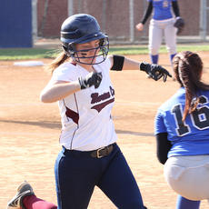 """<div class=""""source"""">Nick Schrager</div><div class=""""image-desc"""">Junior catcher Abby Miles makes it safely to first base in a win over Danville on April 10.</div><div class=""""buy-pic""""><a href=""""/photo_select/33774"""">Buy this photo</a></div>"""