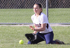 """<div class=""""source"""">Nick Schrager</div><div class=""""image-desc"""">Freshman outfielder Jordan Thomas gets low to scoop the ball into her glove in Marion County's softball win over Danville.</div><div class=""""buy-pic""""><a href=""""/photo_select/33779"""">Buy this photo</a></div>"""