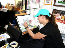 """<div class=""""source"""">Emily LaForme</div><div class=""""image-desc"""">Bardstown artist Aimee Griffith was on site creating beautiful paintings and selling original works for festival visitors.</div><div class=""""buy-pic""""><a href=""""/photo_select/60717"""">Buy this photo</a></div>"""