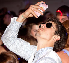 "<div class=""source"">Trina Spalding/The Digital Touch</div><div class=""image-desc"">Satchel Tatum takes a ""selfie"" while on the dance floor. </div><div class=""buy-pic""></div>"