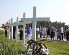 "<div class=""source"">Stevie Lowery</div><div class=""image-desc"">Family members, friends, classmates and community members gathered at the site of the crash that killed five young men 50 years ago on May 25, 1964.</div><div class=""buy-pic""><a href=""/photo_select/34720"">Buy this photo</a></div>"