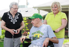 "<div class=""source"">Stephen Lega</div><div class=""image-desc"">Bernadine Thomas chats with Caldwell as Edith Caldwell pushes him closer to the tractor. Thomas is Caldwell's sister, and Edith Caldwell is his sister-in-law. </div><div class=""buy-pic""><a href=""/photo_select/34775"">Buy this photo</a></div>"