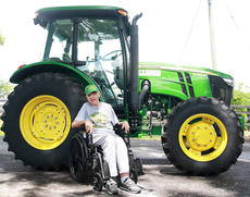 "<div class=""source"">Stephen Lega</div><div class=""image-desc"">Nick Caldwell poses for a photo in front of the John Deere 5085 M. </div><div class=""buy-pic""><a href=""/photo_select/34777"">Buy this photo</a></div>"