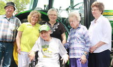 "<div class=""source"">Stephen Lega</div><div class=""image-desc"">Nick Caldwell, front, smiles big while posing for a photo with his family in front of the tractor. From left, they are Paul Caldwell (brother), Edith Caldwell (sister-in-law), Bernadine Thomas (sister), Ilene Young (sister) and Joyce Caldwell (sister-in-law). </div><div class=""buy-pic""><a href=""/photo_select/34778"">Buy this photo</a></div>"