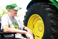 "<div class=""source"">Stephen Lega</div><div class=""image-desc"">Nick Caldwell enjoys getting a closer look at the tractor.</div><div class=""buy-pic""><a href=""/photo_select/34779"">Buy this photo</a></div>"