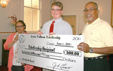 """<div class=""""source""""></div><div class=""""image-desc"""">Cecil also received the Verda Calhoun Scholarship, which is named in memory of the former president of the Marion County NAACP. Calhoun's relatives and friends contributed money to present the scholarship. Marie Mattingly and George Calhoun presented the scholarship to Cecil by on behalf of the family.</div><div class=""""buy-pic""""><a href=""""/photo_select/35451"""">Buy this photo</a></div>"""