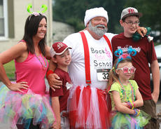 "<div class=""source"">Nick Schrager</div><div class=""image-desc"">Harry VanWhy, dressed as Santa Claus, poses for a photo with some of last year's participants. </div><div class=""buy-pic""><a href=""/photo_select/35866"">Buy this photo</a></div>"