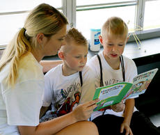"<div class=""source"">Marlena Stokes</div><div class=""image-desc"">Glasscock Elementary School teacher Josie Lyon reads with brothers Alton and Kayden Tongate. </div><div class=""buy-pic""><a href=""/photo_select/67624"">Buy this photo</a></div>"