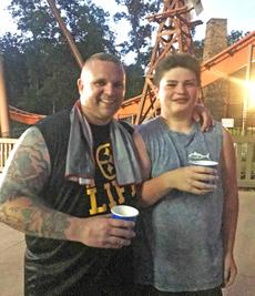 """<div class=""""source"""">Emily LaForme</div><div class=""""image-desc"""">Most people have that one person in their life that has a profound impact on them. Maybe it's a parent, a relative, a teacher or a coach. My brother has Coach Fred, who pushes him on and off the football field. Coach Fred recently helped my brother face one of his biggest fears: rollercoasters. As you can see from the smiles on their faces, it was a huge success.</div><div class=""""buy-pic""""></div>"""