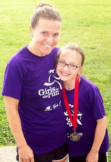 "<div class=""source"">Photo submitted</div><div class=""image-desc"">Pictured is Stevie Lowery, Girls on the Run head coach and newly-appointed Girls on the Run Central Kentucky board of director. Lowery is pictured with Brianna Mattingly, a member of the inaugural class of Marion County's Girls on the Run program at Glasscock Elementary School.
