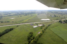 """<div class=""""source"""">Nicolas Schrager</div><div class=""""image-desc"""">Individuals take off from Arnold's airport, which has a grass runway.  </div><div class=""""buy-pic""""><a href=""""/photo_select/36567"""">Buy this photo</a></div>"""