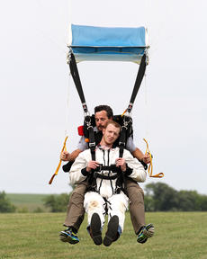 """<div class=""""source"""">Nicolas Schrager</div><div class=""""image-desc"""">Jamie Morris glides into the drop zone attached to Shawn Barnett  </div><div class=""""buy-pic""""><a href=""""/photo_select/36572"""">Buy this photo</a></div>"""