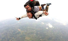 """<div class=""""source"""">Troy Woods</div><div class=""""image-desc"""">Jamie Morris has a blast as he descends back to earth. Also pictured is parachuter Shawn Bernett.</div><div class=""""buy-pic""""><a href=""""/photo_select/36583"""">Buy this photo</a></div>"""