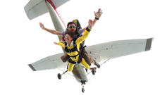 """<div class=""""source"""">Troy Woods</div><div class=""""image-desc"""">Sharon """"Sam"""" Bach and her parachuting partner, Shawn Barnett, free fall through the sky after exiting the airplane. </div><div class=""""buy-pic""""></div>"""