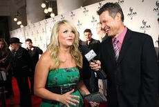 """<div class=""""source""""></div><div class=""""image-desc"""">Pictured is Trent Clutts with country music singer Miranda Lambert. </div><div class=""""buy-pic""""></div>"""