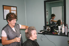 "<div class=""source"">unknown</div><div class=""image-desc"">Mary Rita McClure trims the hair of Madge Reed, 82, of East Main Street in Bradfordsville. She is the mother of two sons, Gary, 58, and Ricky, 57, and retired from Jane and Linda Sportswear No. 2.</div><div class=""buy-pic""><a href=""/photo_select/57441"">Buy this photo</a></div>"