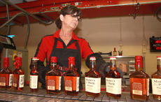 "<div class=""source"">Stephen Lega</div><div class=""image-desc"">Grace Mattingly grabs a bottle to be dipped from the conveyor belt on the bottling line. </div><div class=""buy-pic""><a href=""/photo_select/36675"">Buy this photo</a></div>"