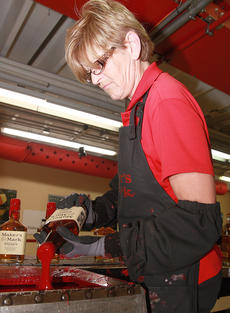 "<div class=""source"">Stephen Lega</div><div class=""image-desc"">Jenny Spannknebel dips a bottle into Maker's Mark's signature red wax. </div><div class=""buy-pic""><a href=""/photo_select/36680"">Buy this photo</a></div>"
