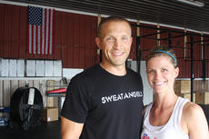 """<div class=""""source"""">Stevie Lowery</div><div class=""""image-desc"""">Ross Wright and his wife, Sarah Ballard Wright, opened CrossFit E2 in July. E2 stands for """"Equipping and Encouraging."""" It is located at 1550 Springfield Road in Lebanon. To find out more about it, go to the website at http://www.crossfite2.com or call 270-699-5187.</div><div class=""""buy-pic""""><a href=""""/photo_select/36687"""">Buy this photo</a></div>"""