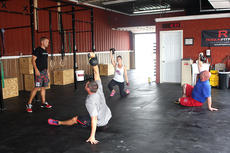 """<div class=""""source"""">Stevie Lowery</div><div class=""""image-desc"""">CrossFit E2 owner and certified trainer Ross Wright watches his 12:15 p.m. Friday class do Turkish get ups. Ross is very cautious about making sure people use proper form with all of the exercises. Also pictured are Ross's wife, Sarah Ballard Wright, Andrew Bertram and Jason Mattingly. Not pictured is Troy Thompson.</div><div class=""""buy-pic""""><a href=""""/photo_select/36689"""">Buy this photo</a></div>"""
