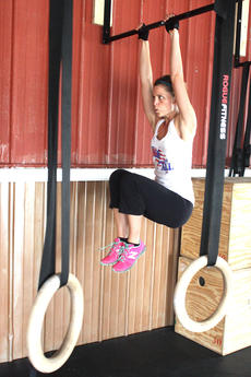 """<div class=""""source"""">Stevie Lowery</div><div class=""""image-desc"""">Sarah Ballard Wright does a modified version of the toes to bar exercise by raising her knees instead of her toes. The exercise focuses on strengthening your mid-section.</div><div class=""""buy-pic""""><a href=""""/photo_select/36690"""">Buy this photo</a></div>"""