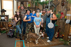 "<div class=""source"">Photo by Bramel Professional Photography</div><div class=""image-desc"">Austin Myers is pictured with the entire Animal Planet ""Call of the Wildman"" crew, including Turtleman's mother, Squirrel, Jake and Neal. Jake is holding Austin's sister, Jessica. </div><div class=""buy-pic""></div>"