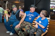 "<div class=""source"">Photo by Bramel Professional Photography</div><div class=""image-desc"">Austin Myers gets the personal attention of Turtleman and Neal James. </div><div class=""buy-pic""></div>"