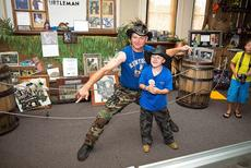 "<div class=""source"">Photo by Bramel Professional Photography</div><div class=""image-desc"">Turtleman and Austin Myers pose for photos at the Marion County Heritage Center, which houses the Turtleman exhibit. </div><div class=""buy-pic""></div>"