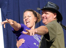 "<div class=""source""></div><div class=""image-desc"">Publisher Stevie Lowery and the Turtleman pose for a photo during the 2011 Marion County Country Ham Days festival.</div><div class=""buy-pic""></div>"