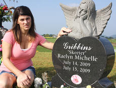 """<div class=""""source"""">Stevie Lowery</div><div class=""""image-desc"""">Shelly Gribbins was hit by a drunk driver on July 14, 2009, and the crash killed her unborn baby, Raelyn Michelle """"Skeeter"""" Gribbins. """"To this day, it's still a shock to me. I still can't believe it happened,"""" Gribbins said. She is pictured alongside her daughter's grave at Old Liberty Cemetery.</div><div class=""""buy-pic""""><a href=""""/photo_select/29573"""">Buy this photo</a></div>"""