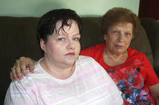 """<div class=""""source"""">Stevie Lowery</div><div class=""""image-desc"""">Carrie Mann, left, and her mother, Fern Cooley, both of Lebanon, were hit head-on on Jan. 24, 2012, on Springfield Highway in Washington County. The driver of the other vehicle, Judy O. Filiatreau of Springfield, was charged with two counts of first-degree assault, one count of first-degree wanton endangerment and DUI, second offense. This case is ongoing in Washington Circuit Court.</div><div class=""""buy-pic""""><a href=""""/photo_select/29575"""">Buy this photo</a></div>"""