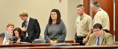 """<div class=""""source"""">Calen McKinney</div><div class=""""image-desc"""">Flanked by security officers, Tonya Ford walks into the Taylor Circuit Courtroom in handcuffs to receive her prison sentence after being found guilty last month of murdering her husband.</div><div class=""""buy-pic""""><a href=""""/photo_select/22643"""">Buy this photo</a></div>"""