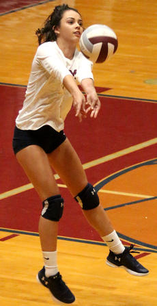 """<div class=""""source"""">Gerard Flanagan</div><div class=""""image-desc"""">Kelly Miles bumps the ball in Marion County's win over Campbellsville on Thursday at the Roby Dome.</div><div class=""""buy-pic""""><a href=""""/photo_select/63708"""">Buy this photo</a></div>"""