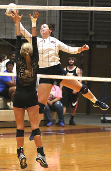 """<div class=""""source"""">Gerard Flanagan</div><div class=""""image-desc"""">Emma Sullivan stretches out to get the ball over Campbellsville's Tatem Wiseman in Marion County's win over Campbellsville on Thursday at the Roby Dome.</div><div class=""""buy-pic""""><a href=""""/photo_select/63710"""">Buy this photo</a></div>"""