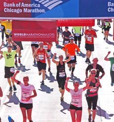 """<div class=""""source"""">MarathonFoto</div><div class=""""image-desc"""">Stevie Lowery, pictured in the black tank top with her arms raised to the sky, ran the Chicago Marathon on Oct. 13.</div><div class=""""buy-pic""""></div>"""