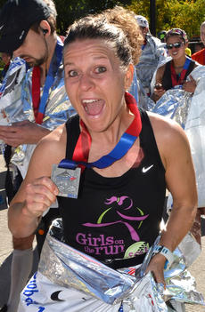 """<div class=""""source"""">MarathonFoto</div><div class=""""image-desc"""">Lowery is pictured ecstatically holding her finisher's medallion.</div><div class=""""buy-pic""""><a href=""""/photo_select/30578"""">Buy this photo</a></div>"""