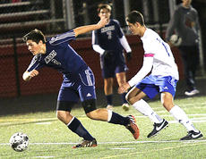 """<div class=""""source"""">Gerard Flanagan</div><div class=""""image-desc"""">Colby Hood breaks away from a North Hardin opponent. </div><div class=""""buy-pic""""><a href=""""/photo_select/45629"""">Buy this photo</a></div>"""
