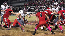 """<div class=""""source"""">George Spragens</div><div class=""""image-desc"""">Marion County's Isaac Mattingly, No. 87, looks for a hole in the Taylor County defense. </div><div class=""""buy-pic""""></div>"""
