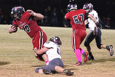 """<div class=""""source"""">George Spragens</div><div class=""""image-desc"""">Marion County's Tyler Livers, No. 53, brings down Taylor County senior Jack Miller. </div><div class=""""buy-pic""""><a href=""""/photo_select/45641"""">Buy this photo</a></div>"""