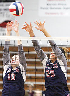 """<div class=""""source"""">Central Kentucky News Journal</div><div class=""""image-desc"""">Madelyn Hagan and Aubrey Logan attempt to block the ball during the district championship game against Taylor County last week. </div><div class=""""buy-pic""""><a href=""""/photo_select/45671"""">Buy this photo</a></div>"""