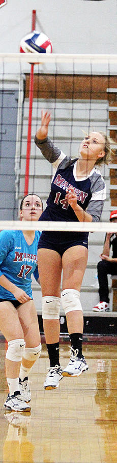 """<div class=""""source"""">Central Kentucky News Journal</div><div class=""""image-desc"""">Savannah Goode hits the ball over the net during the district championship game against Taylor County last week. </div><div class=""""buy-pic""""><a href=""""/photo_select/45672"""">Buy this photo</a></div>"""