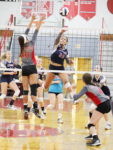 """<div class=""""source"""">Central Kentucky News Journal</div><div class=""""image-desc"""">Aubrey Logan spikes the ball over the net during the district championship game against Taylor County last week. </div><div class=""""buy-pic""""><a href=""""/photo_select/45673"""">Buy this photo</a></div>"""