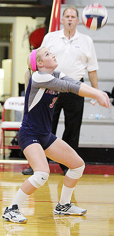 """<div class=""""source"""">Central Kentucky News Journal</div><div class=""""image-desc"""">Caroline Reed sets the ball during the district championship game against Taylor County last week. </div><div class=""""buy-pic""""><a href=""""/photo_select/45674"""">Buy this photo</a></div>"""