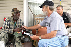"<div class=""source"">Stephen Lega</div><div class=""image-desc"">Sam Epps listens as fellow Vietnam veteran Barney Tharp reads a personal statement of appreciation after presenting Epps with the dog tag. John ""Quincy"" Thomas, at right, contacted the man who found Epps dog tags. </div><div class=""buy-pic""><a href=""/photo_select/45957"">Buy this photo</a></div>"