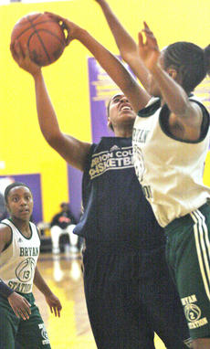 """<div class=""""source"""">Jessica Veatch</div><div class=""""image-desc"""">Junior Alexus Calhoun goes up strong against a Bryan Station defender in the scrimmage Saturday.</div><div class=""""buy-pic""""><a href=""""/photo_select/24118"""">Buy this photo</a></div>"""