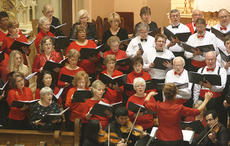 """<div class=""""source"""">Stephen Lega</div><div class=""""image-desc"""">The chorus sings """"He is Come!"""" to open the concert. </div><div class=""""buy-pic""""><a href=""""/photo_select/31644"""">Buy this photo</a></div>"""