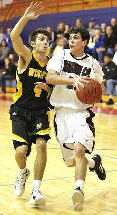 """<div class=""""source"""">Photo by Jessica Veatch</div><div class=""""image-desc"""">Senior John Southall drives past a Woodford County defender in the team's second game of the Fort Harrod Classic last Wednesday night. Southall led the Knights with 18 points in the 57-51 loss.</div><div class=""""buy-pic""""><a href=""""/photo_select/17066"""">Buy this photo</a></div>"""